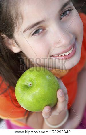 Hispanic girl holding apple