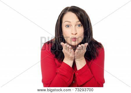 Woman Giving An Air Kiss