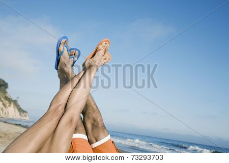 Multi-ethnic couple with feet in air