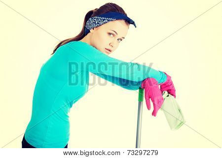 Tired and exhausted cleaning woman