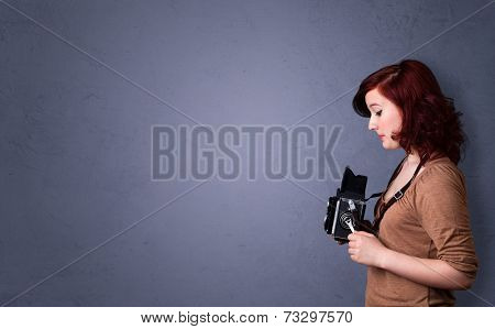 Photographer girl shooting images with copyspace area