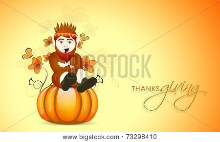 Creative Happy Thanksgiving Day celebrations concept with young tribe man sitting on glossy pumpkin and maple leaves decorated background.