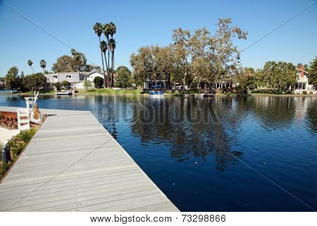 Private Lake with homes and boats in Lake Forest California. Lake Forest has many Private Lakes with limited access to the general public, making it an ideal and serene location to live life.