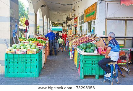 People On An Israel Outdoor Fruit And Vegetable Market
