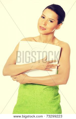 Young beautiful woman is holding weight. Loosing weight conception.