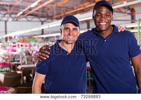 textile co-workers looking at the camera in factory