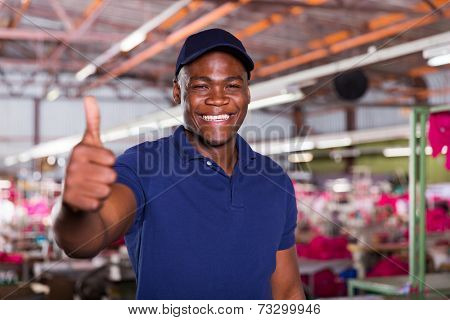 cheerful african american textile worker giving thumb up