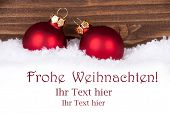 image of weihnachten  - Frohe Weihnachten german Christmas Greetings which means Merry Christmas in the Snow with red Christmas Balls and Space for your Text - JPG