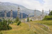 image of hydro-electric  - An electric implant between mountains with many high-voltage poles and cables