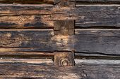 foto of log fence  - Wooden wall from logs as a background texture - JPG
