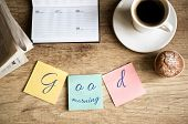 foto of morning  - Good morning on work cup of coffee on wooden desk - JPG
