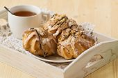 pic of eclairs  - Tasty eclairs on table with tea cup  - JPG