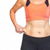 stock photo of body fat  - Female body fat on her abdomen - JPG