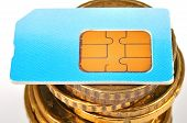 stock photo of micro-sim  - blue sim card and euro coins money close up - JPG