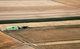 image of ultralight  - grass airstrip and hangar for ultralight between fields - JPG