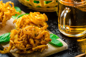 foto of jalapeno  - Crispy Onion Bhajis with creame cheese dip with jalapeno and crunchi toast on spinach leaves and czech beer - JPG