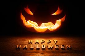image of jack o lanterns  - Spooky Halloween background with jack o lantern  - JPG