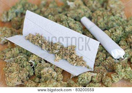 Dry marijuana buds with joint