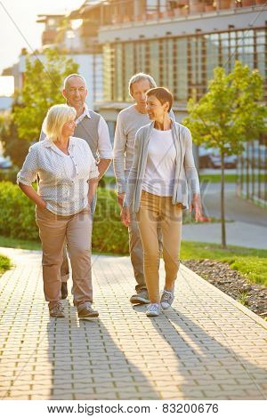 Group of senior people in city going for a walk