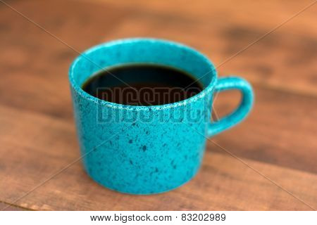 Teal coffee cup
