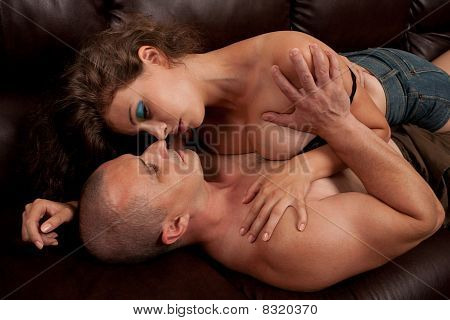 Young Loving Couple On Sofa
