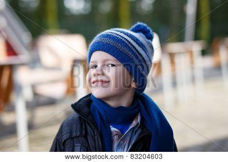 Little Boy In Winter Cap Smile Outdoor