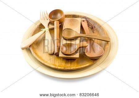 Wooden Spoons In Wooden Plates Isolated On White Background