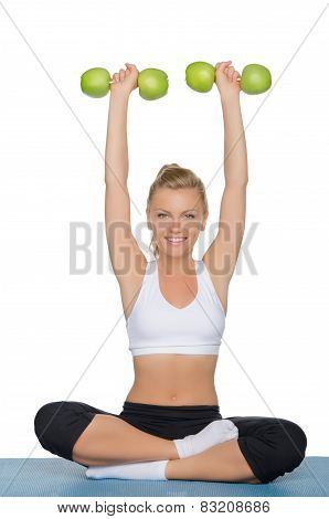 Attractive Woman With Dumbbells Of Green Apples