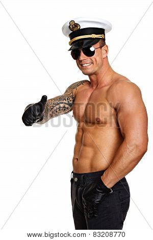 Muscular man shows thumb up