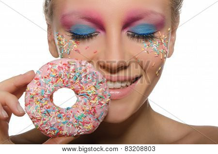 Young Young Woman With Donut In Mouth