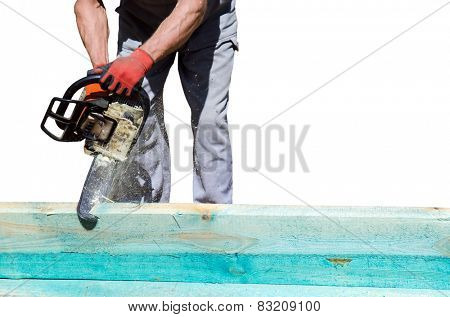 Man sawing a wooden beam with a chain saw