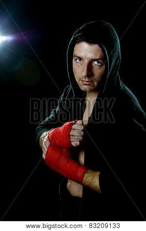 Fighter Man In Boxing Hoodie Jumper With Hood On Head With Hand And Wrist Wrapped Ready For Fighting