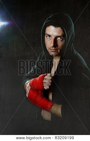 Young Man In Boxing Hoodie Jumper With Hood On Head Wearing Hand And Wrist Wrapped Ready For Fightin
