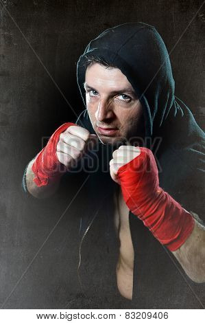 Man In Boxing Hoodie Jumper With Hood On Head With Wrapped Hands Wrists Ready For Fighting