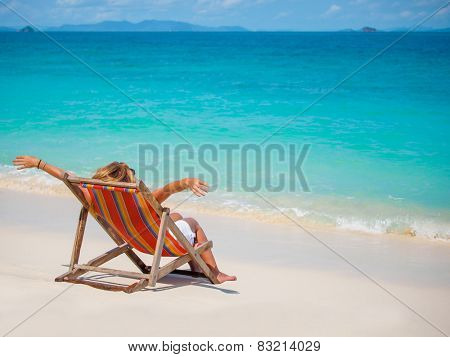 Woman on a tropical beach sunbathing