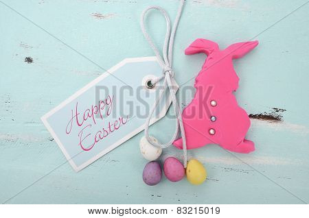 Happy Easter Pink Confectionary Sugar Fondant Cookie Bunny With Greeting Tag On Pale Aqua Blue Shabb