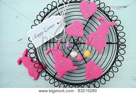Happy Easter Pink Confectionary Sugar Fondant Cookie Bunnies On Vintage Baking Rack On Pale Aqua Blu