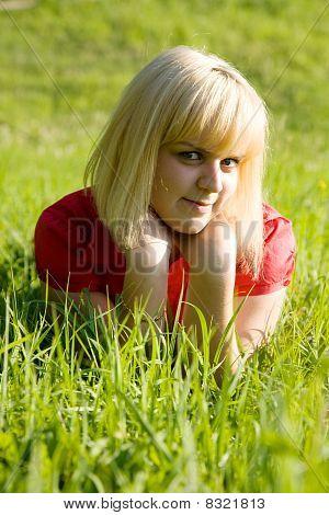 Smiling Girl  On  Grass