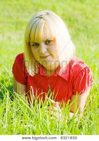 Girl In  Lying On  Grass