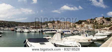 PORT DE SOLLER, MAJORCA, SPAIN - AUGUST 6, 2014: Harbor view in Port de Soller  Mallorca with boats and buildings on August 6, 2014 in  Port de Soller, Majorca, Spain.