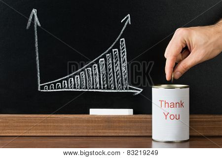 Person Inserting Coin In Thank You Can