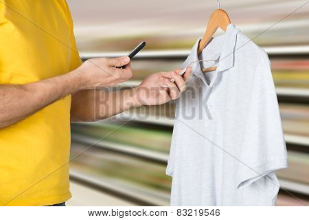 Man Scanning The Price Tag For Shopping