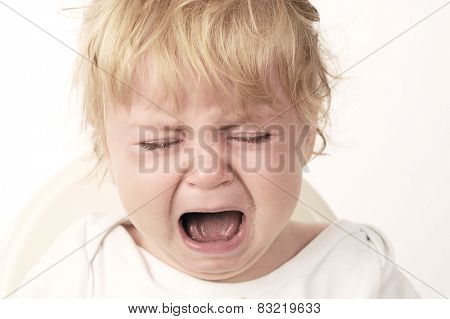 The baby girl eating and crying with white background