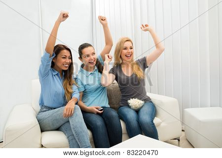 Three Young Women Cheering