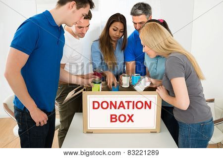 People Looking Inside Donation Box