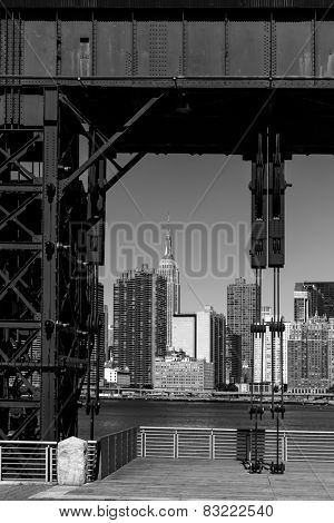 Manhattan New York skyline BW from East River floodgates structure USA