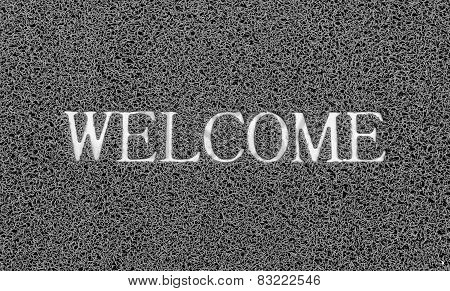 Welcome Title On The Gray Plastic Doormat For Texture Background