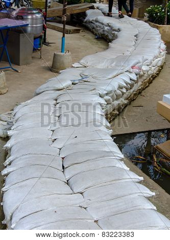 White Sandbags For Flood Defense Overlapping For Pathway