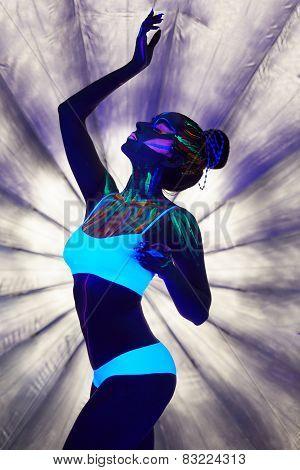 Image of graceful girl with luminous body art
