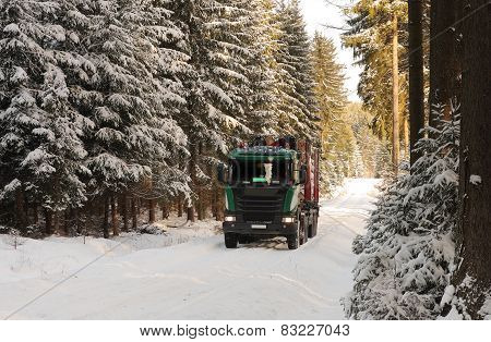 Truck With Log In Road In Forest In Winter
